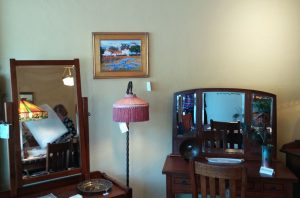 Inside Strictly Mission, find Michele's 12x16 oil painting Hacienda Lupine between 2 mirrored vanities.